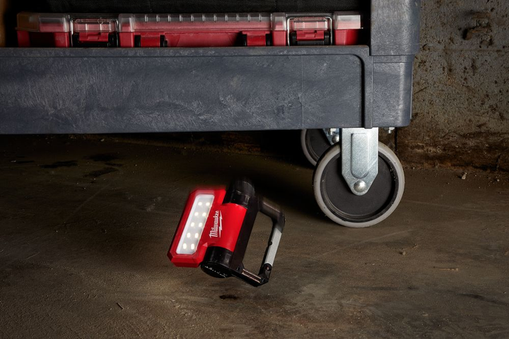 Milwaukee's personal flood light features a 210-degree pivoting head and a magnetic base, allowing it to be used in tight spaces (including under or inside of vehicles).