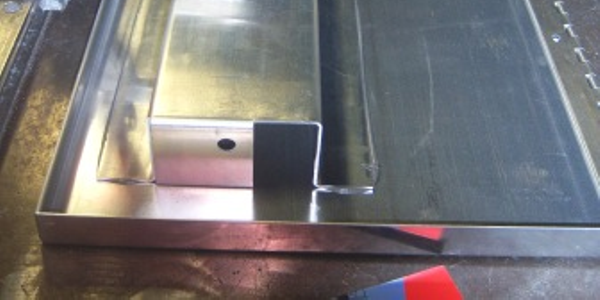 Truck toolbox lid-latch-support joined with a structural adhesive eliminates warpage and stress...
