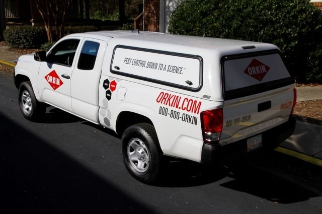 The majority of the Rollins fleet are light-duty Toyota Tacoma trucks, with decals, a topper, toolbox, telematics, cargo net, and other items as standard upfits. (Photo courtesy of Rollins Inc.) -