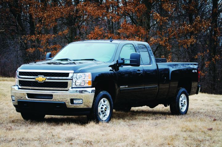 The GMC Sierra and Chevrolet Silverado CNG (left) models can run just on gasoline if no compressed natural gas is available. -
