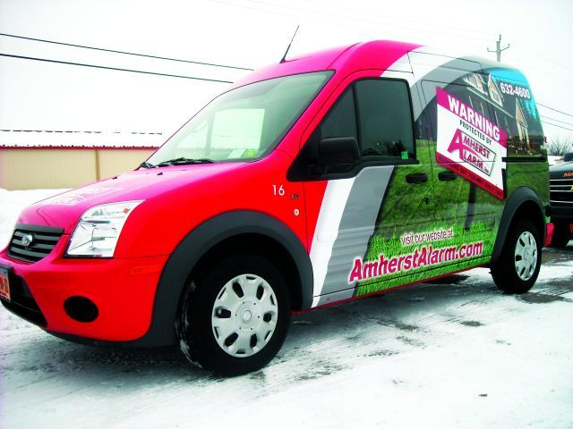Amherst Alarm utilizes an image of it's alarm sign, and includes its website and phone number.  -