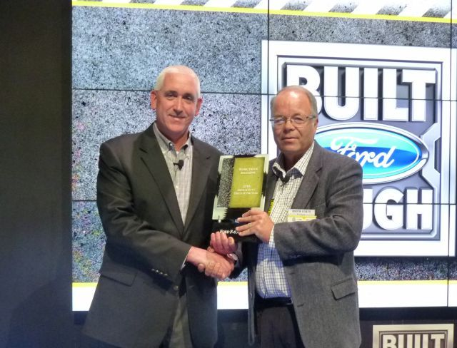 John Ruppert (L), general manager –  Commercial Vehicle Sales & Marketing at Ford Motor Company, accepts the award for the F-650/F-750 from Work Truck's Editor & Associate Publisher, Mike Antich, at a ceremony during the 2016 NTEA – Work Truck Show. (PHOTO: Chris Brown) -