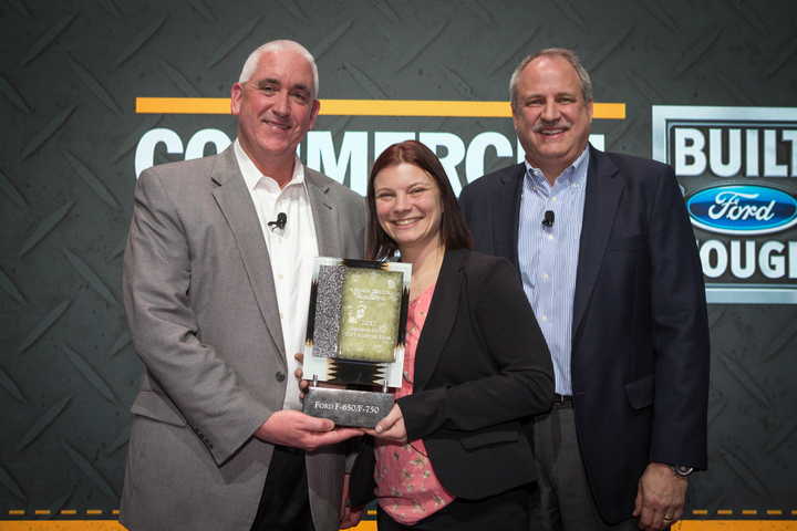 The 2017 Medium-Duty Truck of the Year award was presented to John Ruppert, Ford general manager, commercial vehicle sales and marketing (left) and John Scholtes, Ford chief program engineer, commercial vehicles (right) by Lauren Fletcher, executive editor of WT. (Photo courtesy of Ford Motor Co.) -