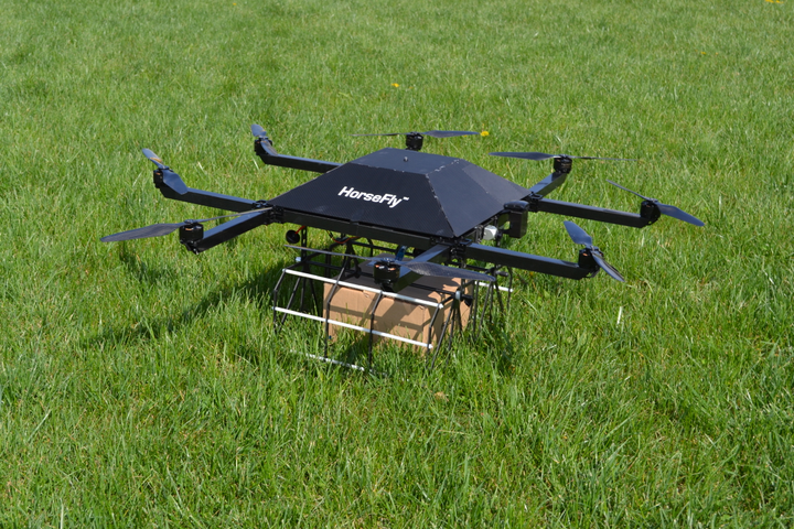 The HorseFly UAV is given a package and a delivery destination by a delivery driver, using a touchscreen interface in the delivery truck. (PHOTO: WORKHORSE) -