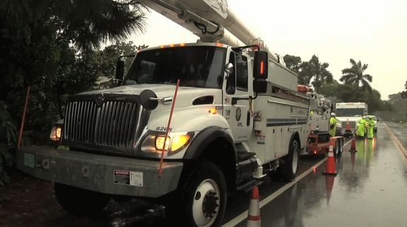 Fleet vehicles from Florida Power & Light take part in storm response training, including demonstrating efficient field work to restore power. (PHOTO: FPL) -