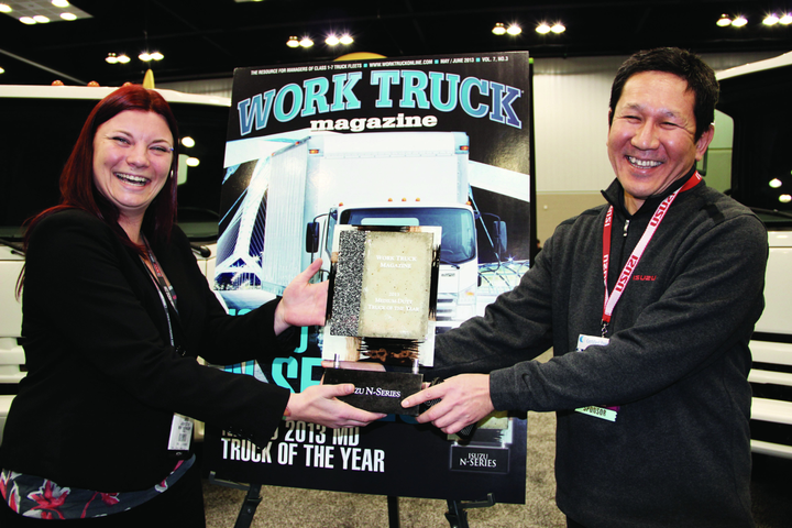 The Medium-Duty Truck of the Year award was presented to Hisao Sasaki, president & COO of ICTA (right) by Lauren Fletcher, managing editor of Work Truck magazine at the 2013 Work Truck Show held in March 2013 in Indianapolis. -