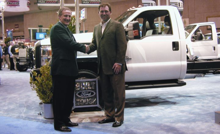 Len Deluca, director, Ford commercial trucks, sales and marketing, (left) accepts congratulations from Bob Brown Jr., Work Truck magazine associate publisher, on the Ford Super Duty's third consecutive recognition as Medium-Duty Truck of the Year. The 2010 award winner was announced at the recent NTEA Work Truck Show in St. Louis. -