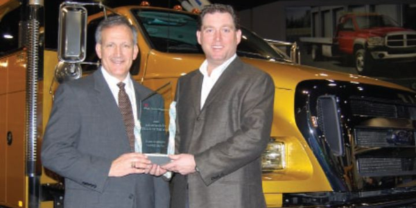Len DeLuca (left), director of Ford Commercial Trucks, accepts the Medium-Duty Truck of the Year...