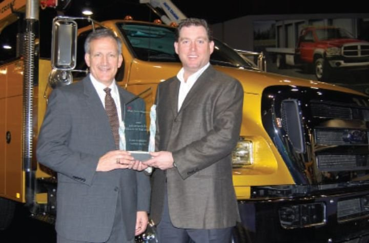 Len DeLuca (left), director of Ford Commercial Trucks, accepts the Medium-Duty Truck of the Year award from Work Truck magazine Associate Publisher Bob Brown at the National Truck Equipment Association's 2008 Work Truck Show in Atlanta. -