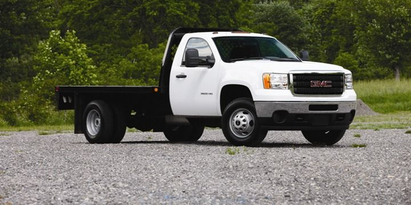 Flatbeds haul heavy materials that don't require an enclosure to protect them from the elements.