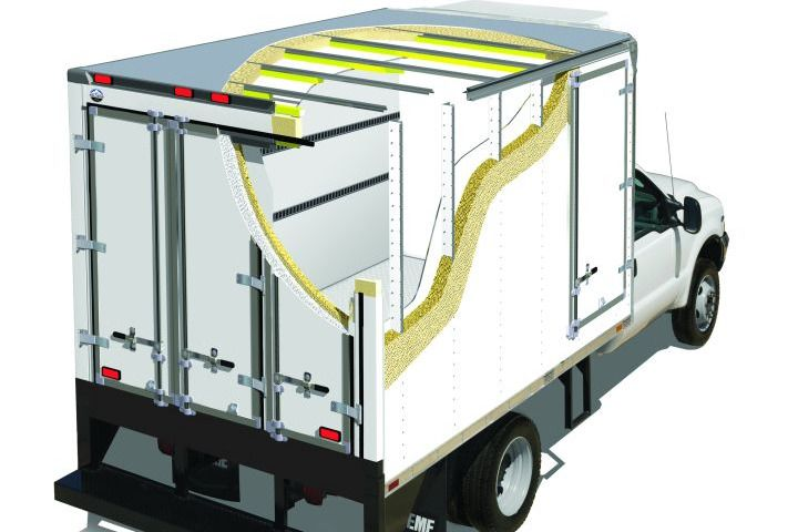 E-track, a steel row of vertical slots recessed into a truck boxes wall, can be added to a refrigerated body to assist with cargo tie-down. -