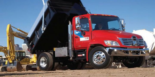 Hino 338 medium-duty model with dump body.
