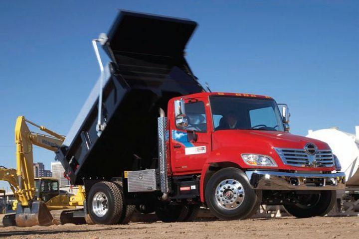 Hino 338 medium-duty model with dump body.  -