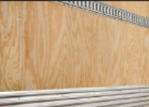 Composed of (top to bottom) wood, plywood, and aluminum or steel, scuff plates are placed on the lower interior walls of the truck box to provide extra protection against damage from a pallet jack or forklift when loading cargo.  -