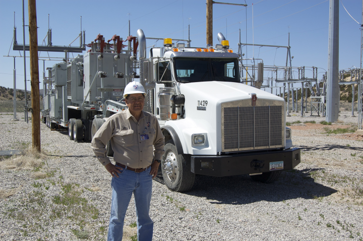 Jimmy Bekis, transportation superintendent for the Navajo Tribal Utility Authority (NTUA) is shown with the company's durable and reliable 1996 Kenworth T800 at the NTUA Mobile Substation.  -