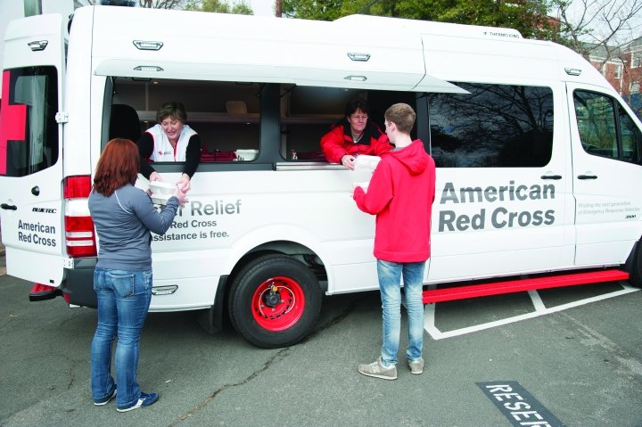 The American Red Cross is testing upfit Sprinter Vans (above left) for its new ERV. The upfit vans feature ergonomic seating and storage so volunteers can easily distribute supplies and food. -