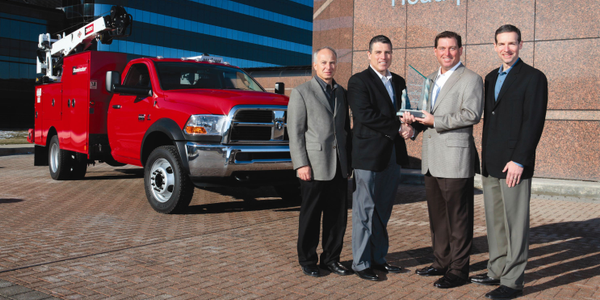 Work Truck magazine Associate Publisher Robert Brown (second from right) presents the 2011...