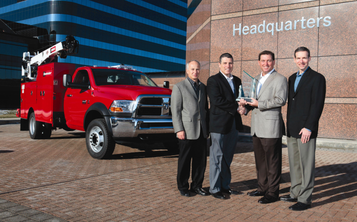Work Truck magazine Associate Publisher Robert Brown (second from right) presents the 2011 Medium-Duty Truck of the Year Award to the Ram Chassis Cab team, (left) Joe Veltri, vice president, Product Planning; Fred Diaz, president and CEO Ram Truck Brand and head of National Sales; and Scott Kunselman, senior vice president, Engineering. Shown in back is the 2011 Ram 4500 Chassis Cab. -