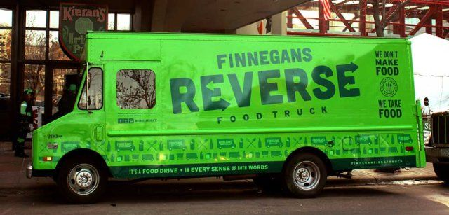Emptying the truck of all interior storage helped allow more room for food. An awning was added, as well as a window to accept donations and a metal table was installed for anyone working the donation window. (PHOTO: FINNEGANS REVERSE FOOD TRUCK) -