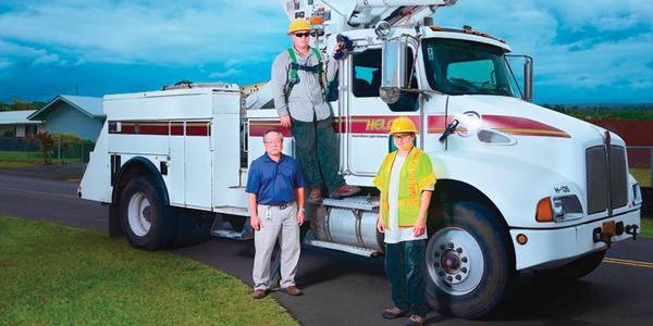 (L-R) Kelvin Kohatsu, Hawaii Electric Light fleet administrator; Joshua Kunimura, Hawaii...