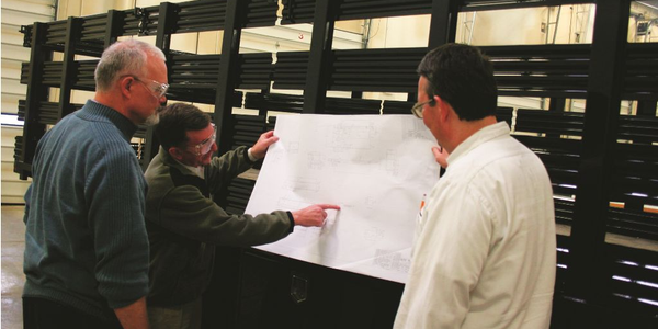 Guy Chollet, engineering manager, Jim Dondlinger, president, and Pete Taskovic, process manager,...
