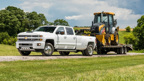 The event, hosted by Chevrolet and John Deere, featured Silverado HD trucks towing John Deere...