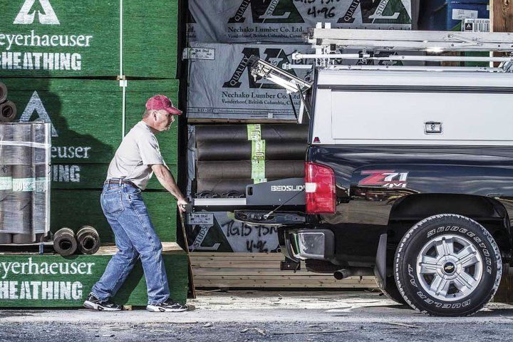 Fleet managers can take advantage of various upfit options, such as a roll out cargo bed (pictured above), to help driver employees safely do their jobs after they get to the job site.  - Photo courtesy of Bedslide