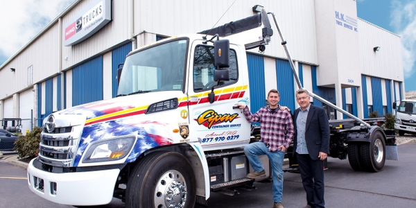 The 1,000th truck is a 2018 Hino 338 outfitted with an American Roll-Off container body. (Photo...