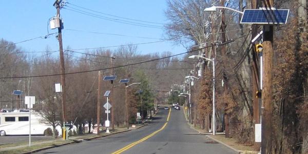 Photo of PSE&G utility poles and solar panels via Mr. Matté/Wikimedia