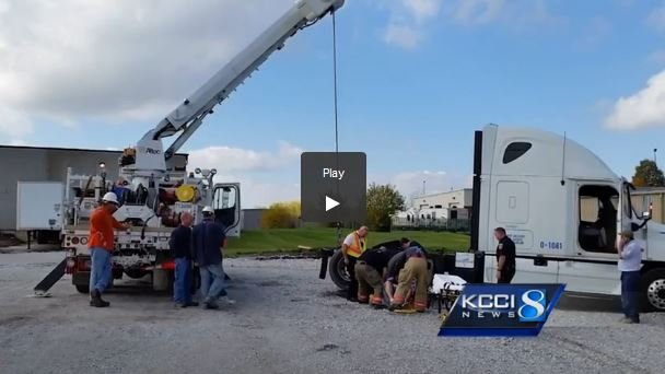 Power Company Rescues Man Trapped Under Semi