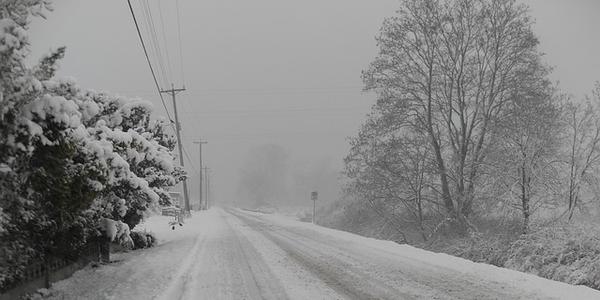 Photo of a snowy street via Pixabay