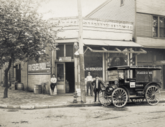 An early example of an International truck being put to use for business purposes.