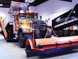 Two Mack Granite model trucks showed off their vocational versatility with dump body and snow...