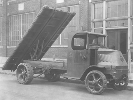 This early 1930s truck uses a chain-driven mechanism to lift the bed, before the development of...