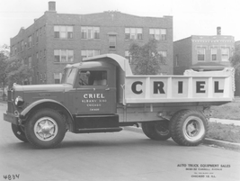 In the 1950s, dump trucks started to take on the more familiar look of today, including this...
