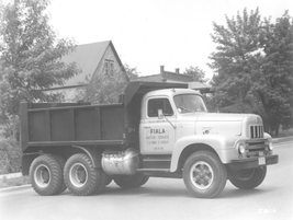Fiala Motor Service also relied on dump trucks, including this six-wheel model from the...
