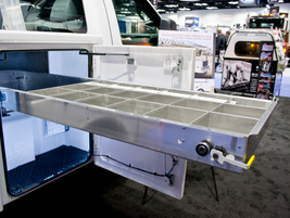 The Truck Accessories Group presented its new products and demonstrated the use of this tray in...
