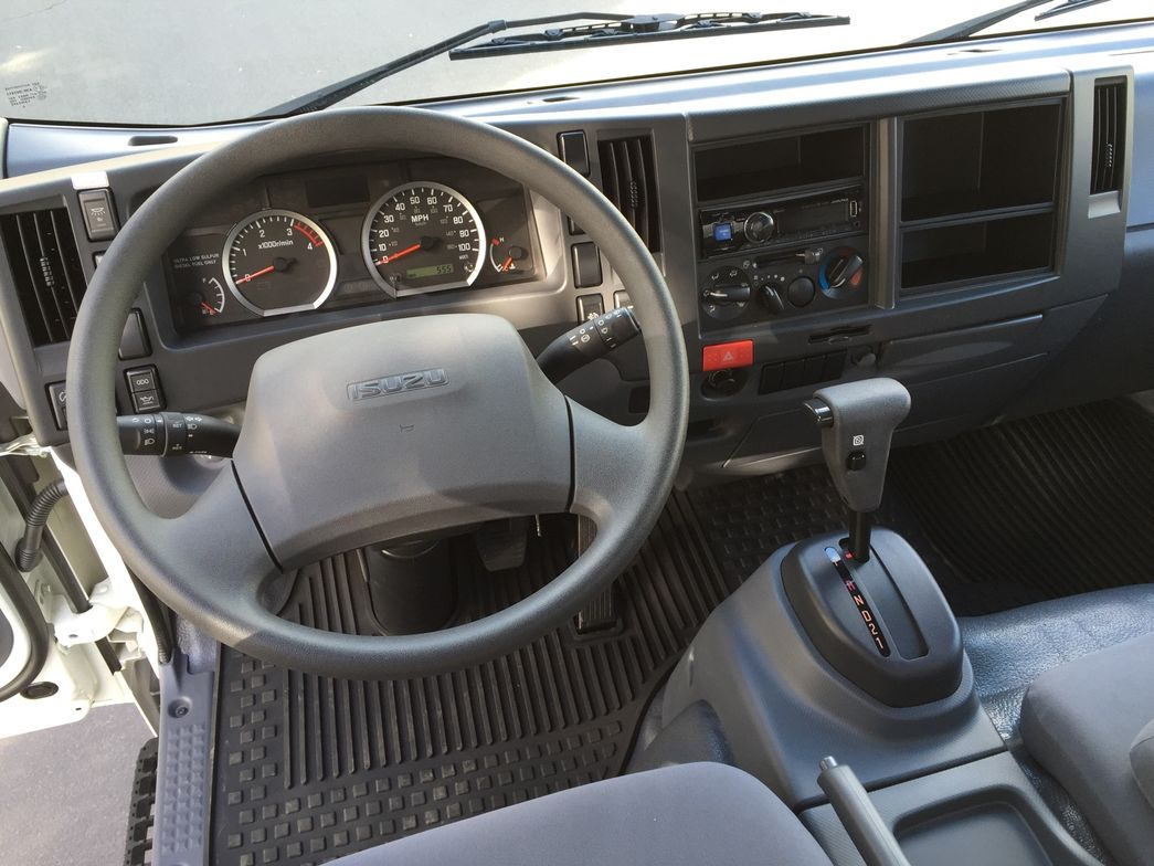 The cabin includes cloth seats, a basic radio, and digital DEF indicator.