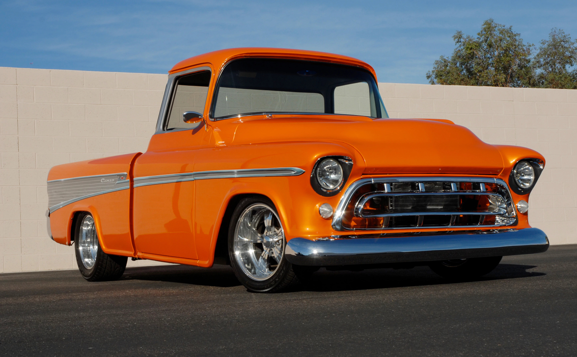 This 1957 Chevrolet Cameo Pickup, finished in full custom Orange Pearl paint, sold for $159,500...