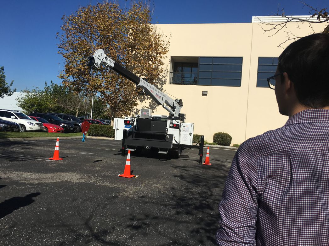 Bobit Business Media editors take turns navigating the crane across a line of cones. (Photo:...