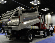 Highway Equipment's XT3 Type II multi-purpose dump body features a front telescopic hoist for a...