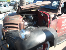 The engine compartment and front hood of the Lurch's Electrical Repair truck.