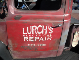 A fun old truck with original advertising for Lurch's Electrical repair.