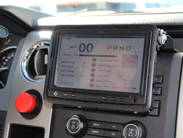 Inside, a flip-up touchscreen tablet allows drivers to select one of the vehicle's multi-modes...