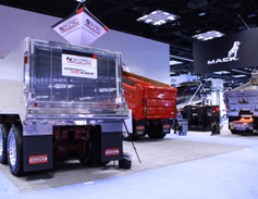 Crysteel displayed its new aluminum dump body, equipped with a single-acting front-mount...