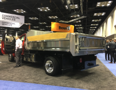Showing off the capabilities of its chassis, General Motors displayed this dump body mounted...