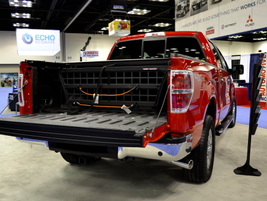 Roll-n-Lock displays its bed system to help secure equipment.