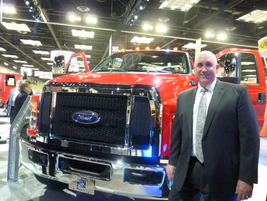 John Ruppert, head of Ford's commercial truck division, stands in front of the all-new Ford...